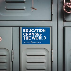 "A locker with a sticker on it that says ""education changes the world""."